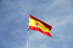Flag of spain, against a blue sky Royalty Free Stock Photo