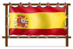 The flag of Spain attached to the wooden frame Royalty Free Stock Photo