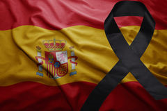 Flag of spain with black mourning ribbon. Waving national flag of spain with black mourning ribbon Royalty Free Stock Images