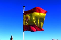 Flag of Spain blowing in the wind royalty free stock photo