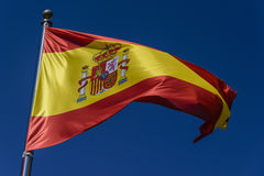 Flag of Spain. On a blue background Royalty Free Stock Photo