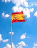 Flag of Spain. On blue sky Royalty Free Stock Images