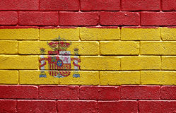 Flag of Spain on brick wall Stock Images