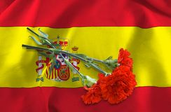 Flag of Spain and flowers close-up Stock Photography