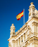 The flag of Spain fluttering on the Cybele Palace in Madrid Stock Photography