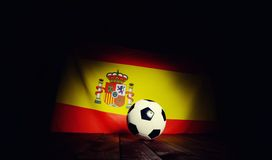 Flag of Spain with football on wooden boards. Stock Images