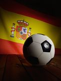 Flag of Spain with football on wooden boards. Stock Photos