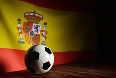 Flag of Spain with football on wooden boards. Stock Photography
