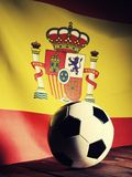 Flag of Spain with football on wooden boards. Royalty Free Stock Images