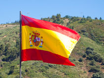 Flag of Spain with mountains at the distance Royalty Free Stock Photos
