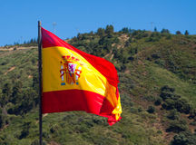 Flag of Spain with mountains at the distance Stock Photography