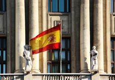 Flag of spain, from a neoclassic building, madrid. The flag of spain, from the balcony of a neoclassic building in madrid, landscape cut Royalty Free Stock Photos