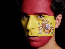 Flag of Spain. Painted on a Face of a Young Man Stock Images