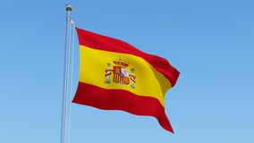 Flag of Spain waving against blue sky. Stock Photos