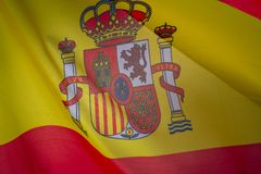 Flag of Spain which waving in the wind on sunny day. Background, close-up stock image