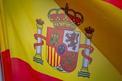 Flag of Spain which waving in the wind on sunny day. Background, close-up stock photography
