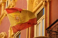 Flag. The Spanish Flag flying over the city of Cartagena, Spain stock photos
