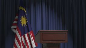 National flag of Malaysia and speaker podium tribune. Political event or statement related conceptual 3D animation