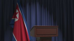 National flag of North Korea and speaker podium tribune. Political event or statement related conceptual 3D animation