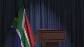 National flag of South Africa and speaker podium tribune. Political event or statement related conceptual 3D animation