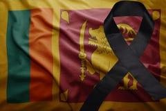 Flag of sri lanka with black mourning ribbon. Waving national flag of sri lanka with black mourning ribbon Royalty Free Stock Photo