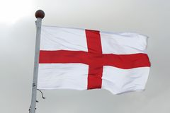 Flag of St George. England flag against a light sky Stock Image
