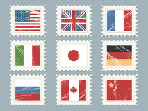 Flag stamps set 1. A collection of nine flag stamps, usa, great britain, france, italy, japan, germany, russia, canada, china Royalty Free Stock Photo
