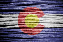 Flag of the state of Colorado. Painted on wood background royalty free stock photos