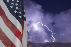 Flag and Storm. American flag displayed during an electrical storm Royalty Free Stock Images