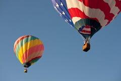 Flag & striped hot air balloons Royalty Free Stock Photos