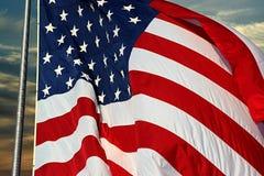 Flag at Sunrise. Symbol of freedom stock photo