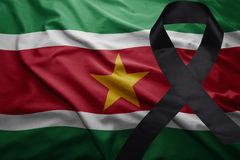 Flag of suriname with black mourning ribbon Royalty Free Stock Image