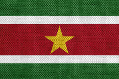 Flag of Suriname on old linen Stock Photos