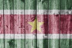 Flag of Suriname on weathered wood Stock Photo
