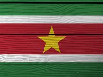 Flag of Suriname on wooden wall background. Grunge Suriname flag texture. Flag of Suriname on wooden wall background. Grunge Suriname flag texture, green and stock photo