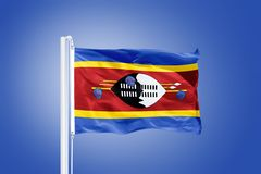 Flag of Swaziland flying against a blue sky Royalty Free Stock Images