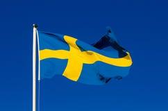 Flag of Sweden. Against the blue sky, national patriotic background Stock Image