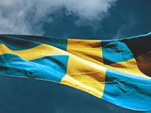 Flag of sweden. Blowing in the wind, blue sky Royalty Free Stock Images