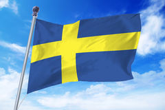 Flag of Sweden developing against a clear blue sky Royalty Free Stock Images