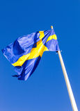 Flag of Sweden. Waving against blue sky Stock Photography