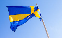 Flag of Sweden waving against sky Stock Image