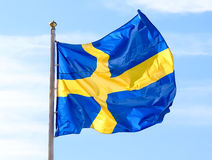 Flag of Sweden waving against sky Stock Photography