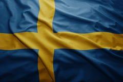 Flag of Sweden. Waving colorful national Swedish flag Stock Image