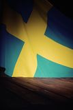 Flag of the Sweden with wooden boards. Royalty Free Stock Photography