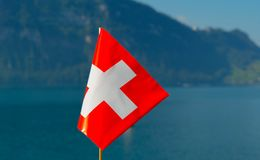 Flag of Switzerland against the backdrop of Lake Lucerne. Flag of Switzerland against the backdrop of Lake Lucerne Royalty Free Stock Photography