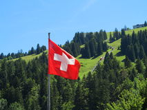 Flag of Switzerland in alpine landscape Stock Photos