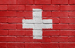 Flag of Switzerland on a brick wall Royalty Free Stock Photos