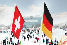 Flag of Switzerland and Germany on wind Royalty Free Stock Photography