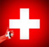 Flag of Switzerland on hand Royalty Free Stock Photography