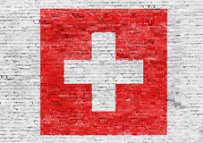 Flag of Switzerland over brick wall Stock Images